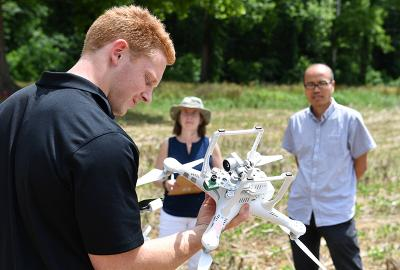 Andrew Broecker, VMI Class of 2022, prepares to fly a drone while Dr. Hongbo Zhang looks on.—VMI Photo by Kelly Nye.